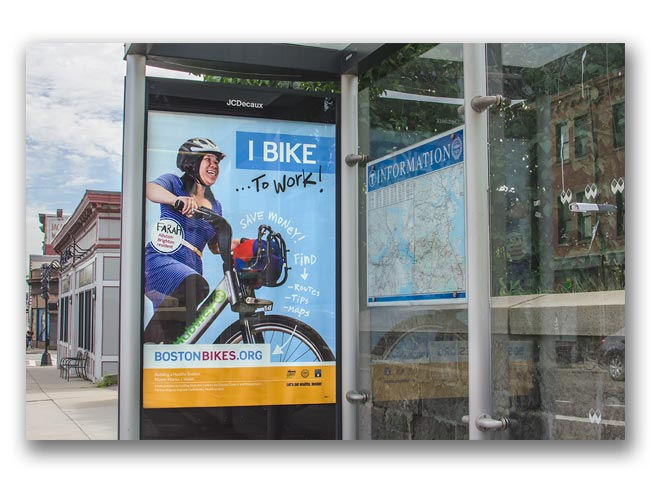 Photo of Let's Get Healthy Boston bike campaign bus shelter poster