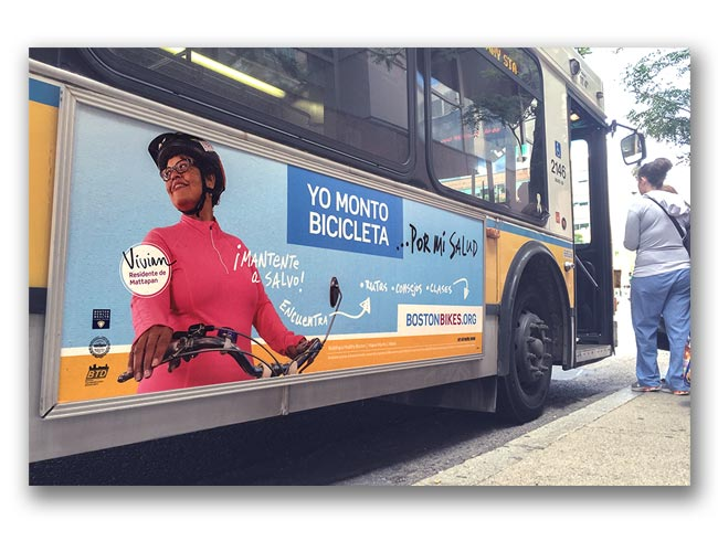 Photo of Let's Get Healthy Boston bike campaign poster on the side of a bus