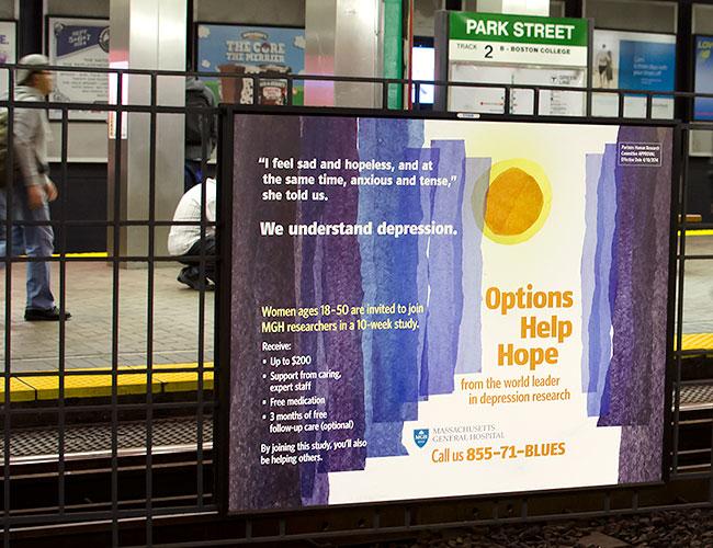Photo of large recruitment poster at Boston subway station